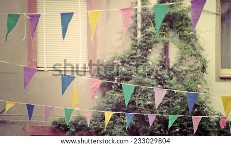 party flags in vintage tone. Shot in Sardinia, Italy. - stock photo