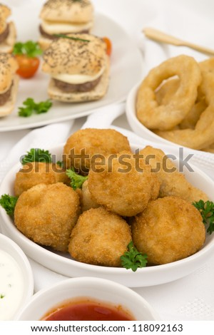 Party Food - Breaded Mushrooms, mini cheeseburgers and onion rings with chili sauce and sour cream and chives dip.