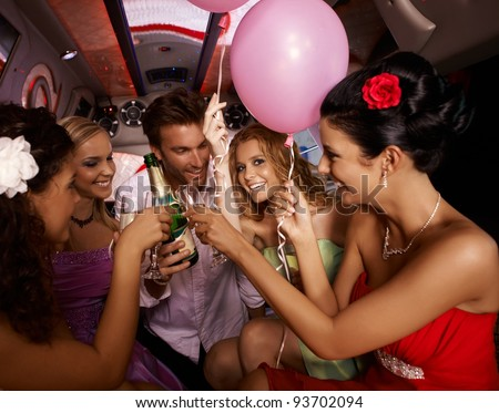 Party fun with champagne in limousine.? - stock photo