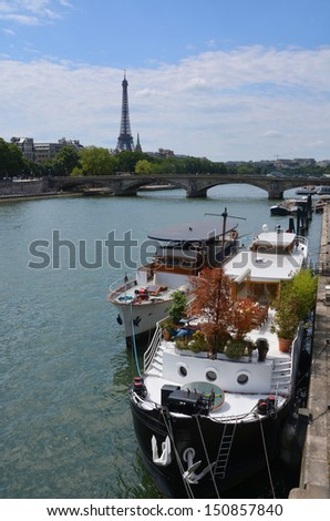 Party & function boats moored on the Seine River with the Eiffel Tower in the background, Paris, France.