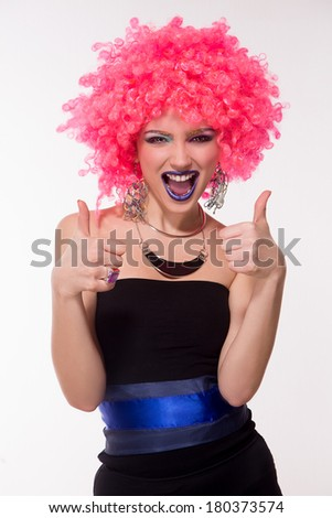 Party girl in pink wig on white - stock photo