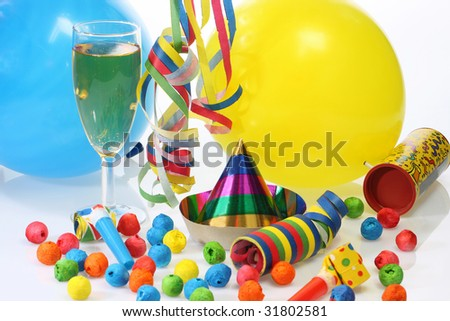 Party goods and champagne on bright background