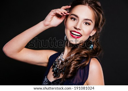 party happy woman with perfect makeup wearing jewelry - stock photo