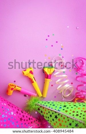 Party hats on pink background