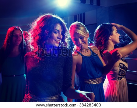 party, holidays, celebration, nightlife and people concept - smiling friends dancing in club - stock photo