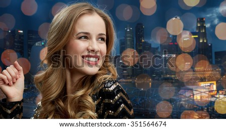 party, holidays, nightlife and people concept - face of happy young woman dancing at night club disco over city and lights background - stock photo