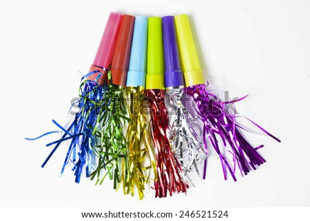 Party Horn Blower with colored streamers on white background - stock photo