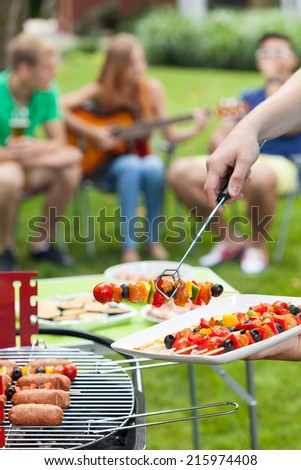 Party in a garden during summer, vertical - stock photo