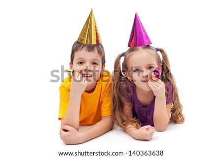 Party kids laying on the floor - isolated