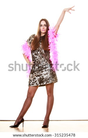 Party new year celebration and carnival concept. Elegant woman in evening sequin dress pink feather boa isolated on white background. - stock photo