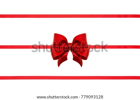 Party red silk ribbon bow with tails and ribbons isolated on white background