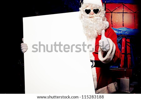 Party Santa Claus holding white board over Christmas background. - stock photo