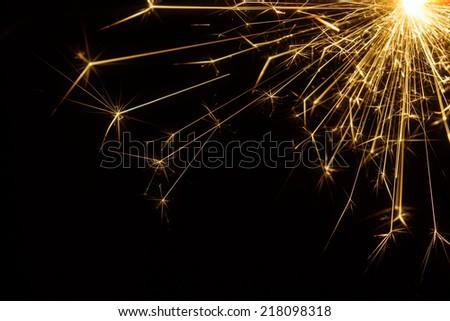 Party sparkler detail in corner - stock photo