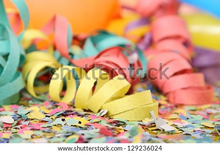 party streamers, confetti and balloons - stock photo