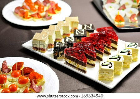 Party table with cakes and canapes  - stock photo