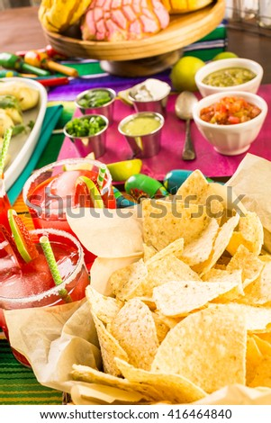 Party table with tamales, strawberry margartisa and pan dulche bread. - stock photo