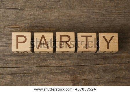 party text on a wooden cubes - stock photo