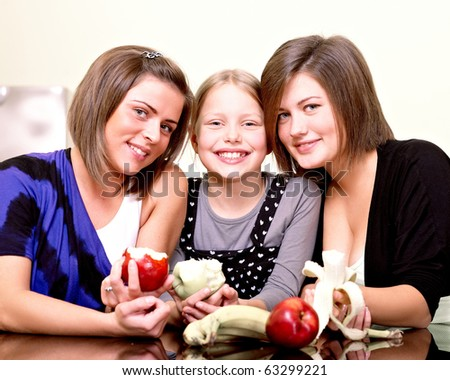 Party. Three cheerful girls. - stock photo