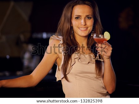 Party woman at the bar with a glass of wine - stock photo