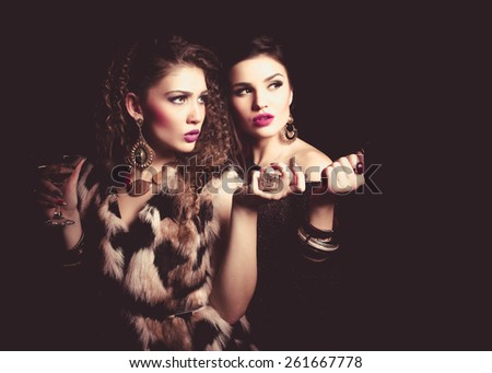 party women dressed up posing - stock photo