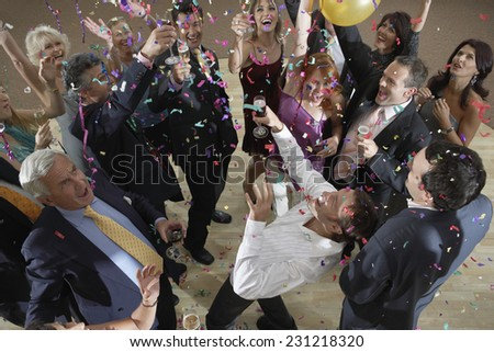 Partygoers at Birthday Party - stock photo