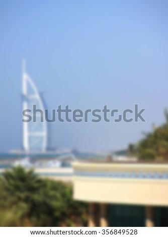 Parus Hotel, Jumeirah Beach and Burj Al Arab Hotel, Dubai United Arab Emirates April 7, 2014, city skiline background, blurred - stock photo