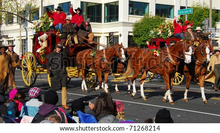 PASADENA, CA - JANUARY 1: The Wells Fargo Bank Horse Carriage float at the 122nd tournament of roses Rose Parade on January 1, 2011 in Pasadena California - stock photo