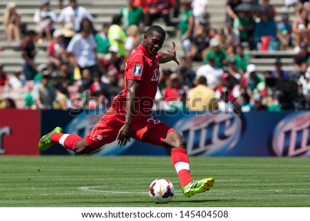 PASADENA, CA - JULY 7: Doneil Henry #20 of Canada during the 2013 CONCACAF Gold Cup game between Canada and Martinique on July 7, 2013 at the Rose Bowl in Pasadena, Ca. - stock photo