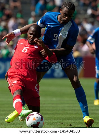 PASADENA, CA - JULY 7: Julian De Guzman #6 of Canada and Frederic Piquionne #9 of Martinique during the 2013 CONCACAF Gold Cup game between Canada and Martinique on July 7, 2013 at the Rose Bowl. - stock photo