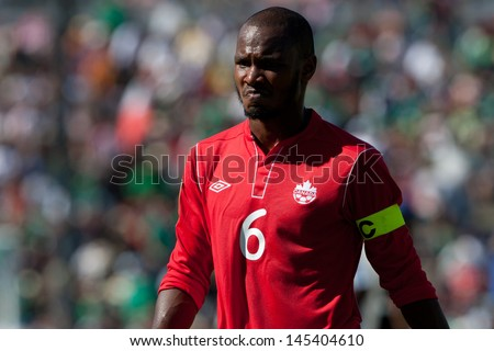 PASADENA, CA - JULY 7: Julian De Guzman reacts to a late winner by Martinique during the 2013 CONCACAF Gold Cup game between Canada and Martinique on July 7, 2013 at the Rose Bowl in Pasadena, Ca. - stock photo