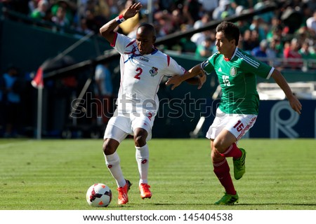 PASADENA, CA - JULY 7: Leonel Parris #2 of Panama and Efrain Velarde #15 of Mexico during the 2013 CONCACAF Gold Cup game between Mexico and Panama on July 7, 2013 at the Rose Bowl in Pasadena, Ca. - stock photo