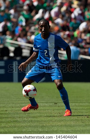 PASADENA, CA - JULY 7: Nicolas Zaire #2 of Martinique during the 2013 CONCACAF Gold Cup game between Canada and Martinique on July 7, 2013 at the Rose Bowl in Pasadena, Ca. - stock photo