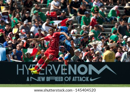 PASADENA, CA - JULY 7: Nicolas Zaire #2 of Martinique & Simeon Jackson #10 of Canada during the 2013 CONCACAF Gold Cup game between Canada & Martinique on July 7, 2013 at the Rose Bowl in Pasadena, Ca - stock photo