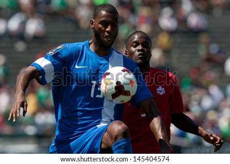 PASADENA, CA - JULY 7: Olivier Thomert #13 of Martinique controls the ball during the 2013 CONCACAF Gold Cup game between Canada and Martinique on July 7, 2013 at the Rose Bowl in Pasadena, Ca. - stock photo