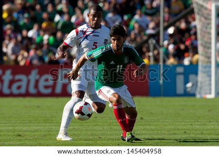PASADENA, CA - JULY 7: Rafael Marquez #11 of Mexico and Roman Torres #5 of Panama in action during the 2013 CONCACAF Gold Cup game between Mexico and Panama on July 7, 2013 at the Rose Bowl - stock photo