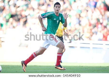 PASADENA, CA - JULY 7: Raul Jimenez #9 of Mexico during the 2013 CONCACAF Gold Cup game between Mexico and Panama on July 7, 2013 at the Rose Bowl in Pasadena, Ca. - stock photo