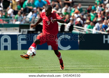 PASADENA, CA - JULY 7: Tosaint Ricketts #9 of Canada in action during the 2013 CONCACAF Gold Cup game between Canada and Martinique on July 7, 2013 at the Rose Bowl in Pasadena, Ca. - stock photo