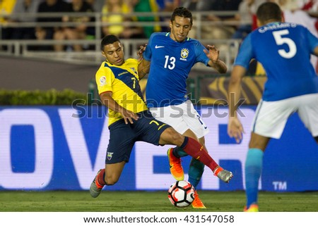 PASADENA, CA - JUNE 4: Jefferson Montero (L) & Marquinhos during the COPA America game between Brazil & Ecuador on June 4th 2016 at the Rose Bowl in Pasadena, Ca. - stock photo