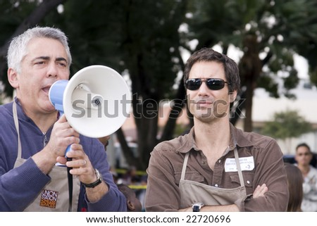 PASADENA, CA - NOVEMBER 27: Actrors Eric McCormack and Adam Arkin help feed the homeless at Central Park, Union Station on November 27, 2008 in Pasadena, California. - stock photo