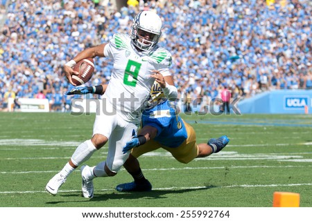 PASADENA, CA. - OCT 11: Oregon QB Marcus Mariota in action during the UCLA football game on October 11th 2014 in Pasadena, California. - stock photo
