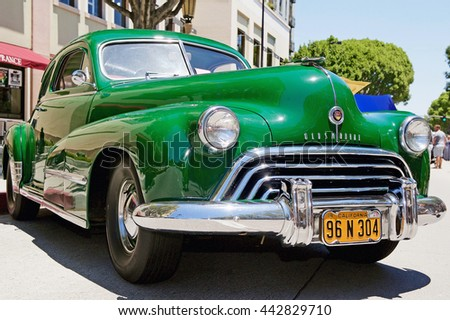 PASADENA, CALIFORNIA - JUNE 19, 2016: A classic 1948 Oldsmobile parked along the road on Green Street in Pasadena, California USA