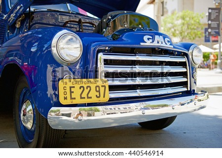 PASADENA/CALIFORNIA - JUNE 19, 2016: A tightly cropped image of a Classic 1949 GMC truck grille parked along the road in Pasadena, California USA  - stock photo