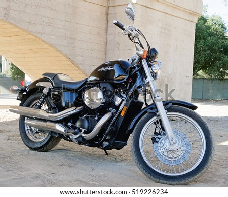 "PASADENA/CALIFORNIA - NOV. 10, 2016: Honda ""Shadow"" Motorcycle parked in a field in Pasadena, California USA"
