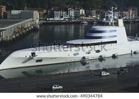 PASAJES, SPAIN - SEPTEMBER 28, 2016: A Hamilton, the luxury yacht, arrived to Pasaia's harbour, Guipuzcoa.