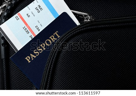 pasport and bording pass in a suitcase