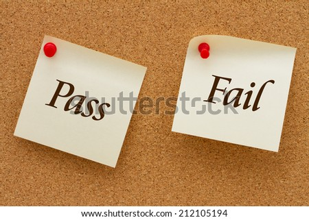 Pass or Fail, Two yellow sticky notes on a cork board with the words Pass and Fail - stock photo