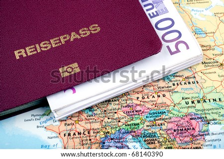pass with bank notes and road map - stock photo