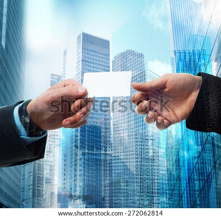 Passage of business card between business person - stock photo