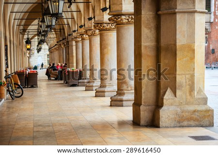 Passage of the gothic hall with columns. Main market square of Krakow city, Poland - stock photo
