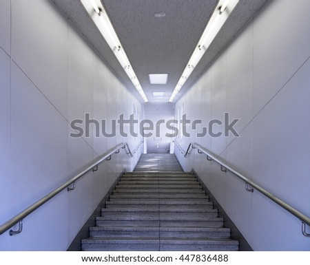 Passage way with stairs going underground in a subway